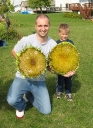 Jack and Dad showing off their sunflower heads